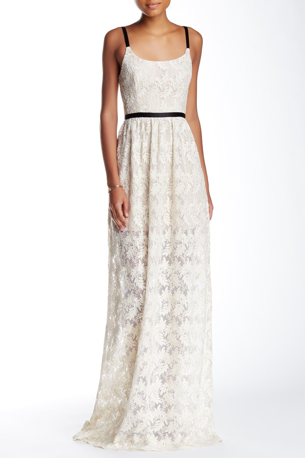 This gorgeous lace gown is perfect for a laid back wedding.