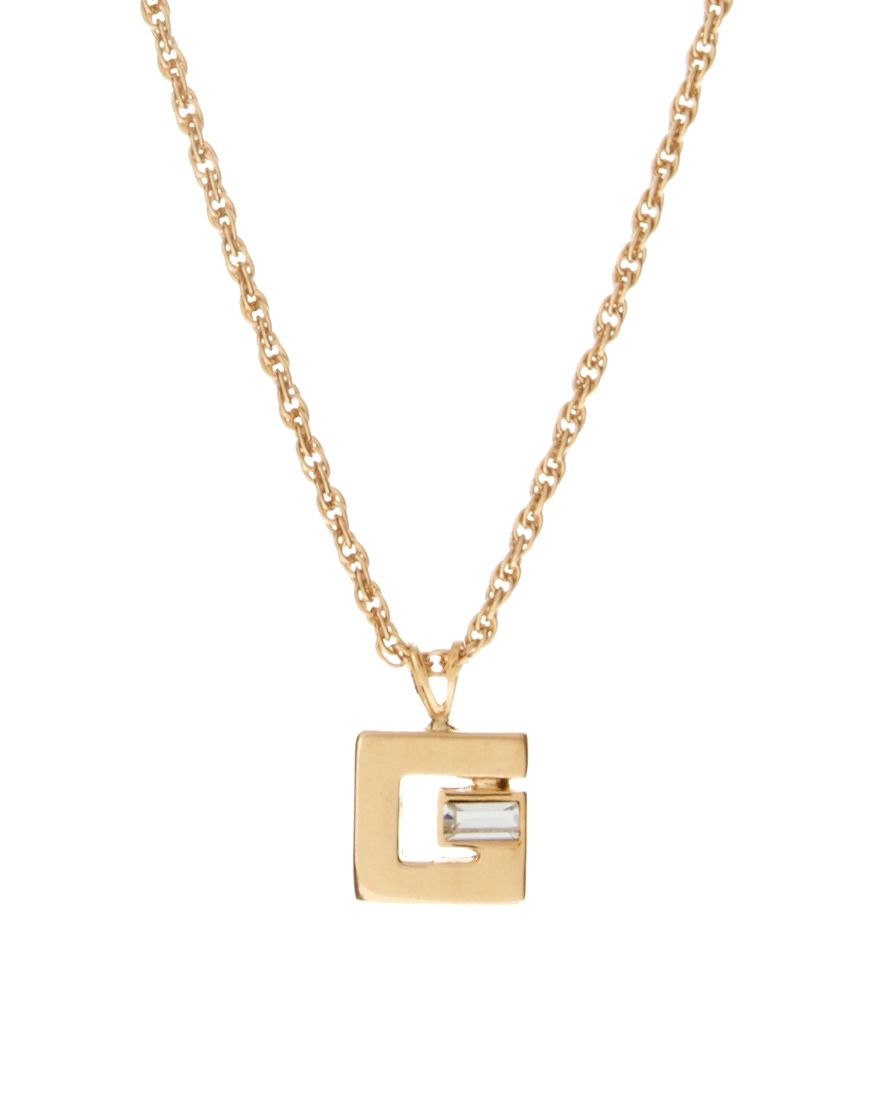 Vintage givenchy gold plated square g logo pendant and diamante