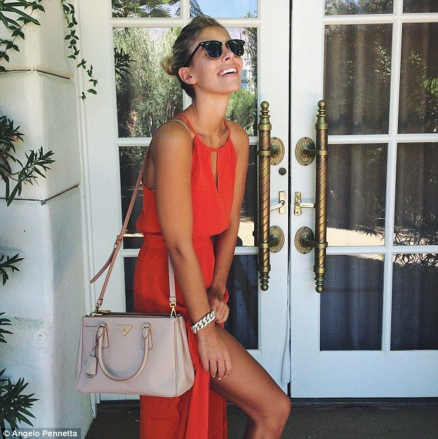 d3cb6d758d2 Vision in orange  Australian-born beauty Natasha Oakley flashed her bright  smile in the sn.