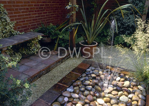 Another pebble garden water feature new backyard ideas for Pebbles in backyard