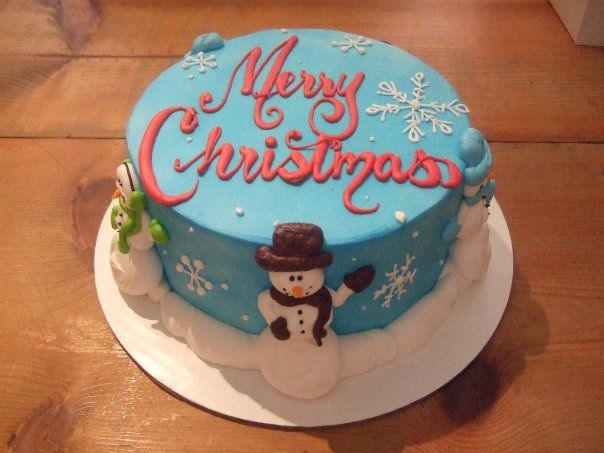 Blue Fondant With White Snowmen On The Sides Of The Cake Merry