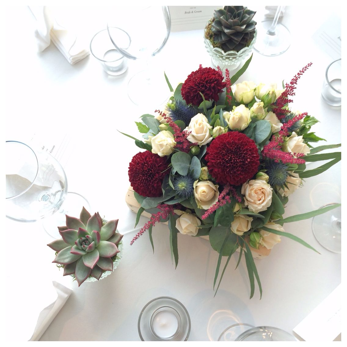 Table arrangements flanked with succulents Kiev