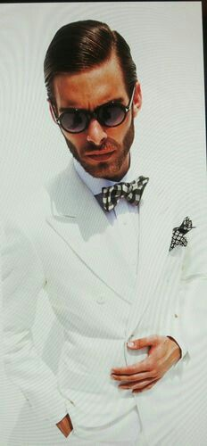 Tom Ford white double breasted suit.