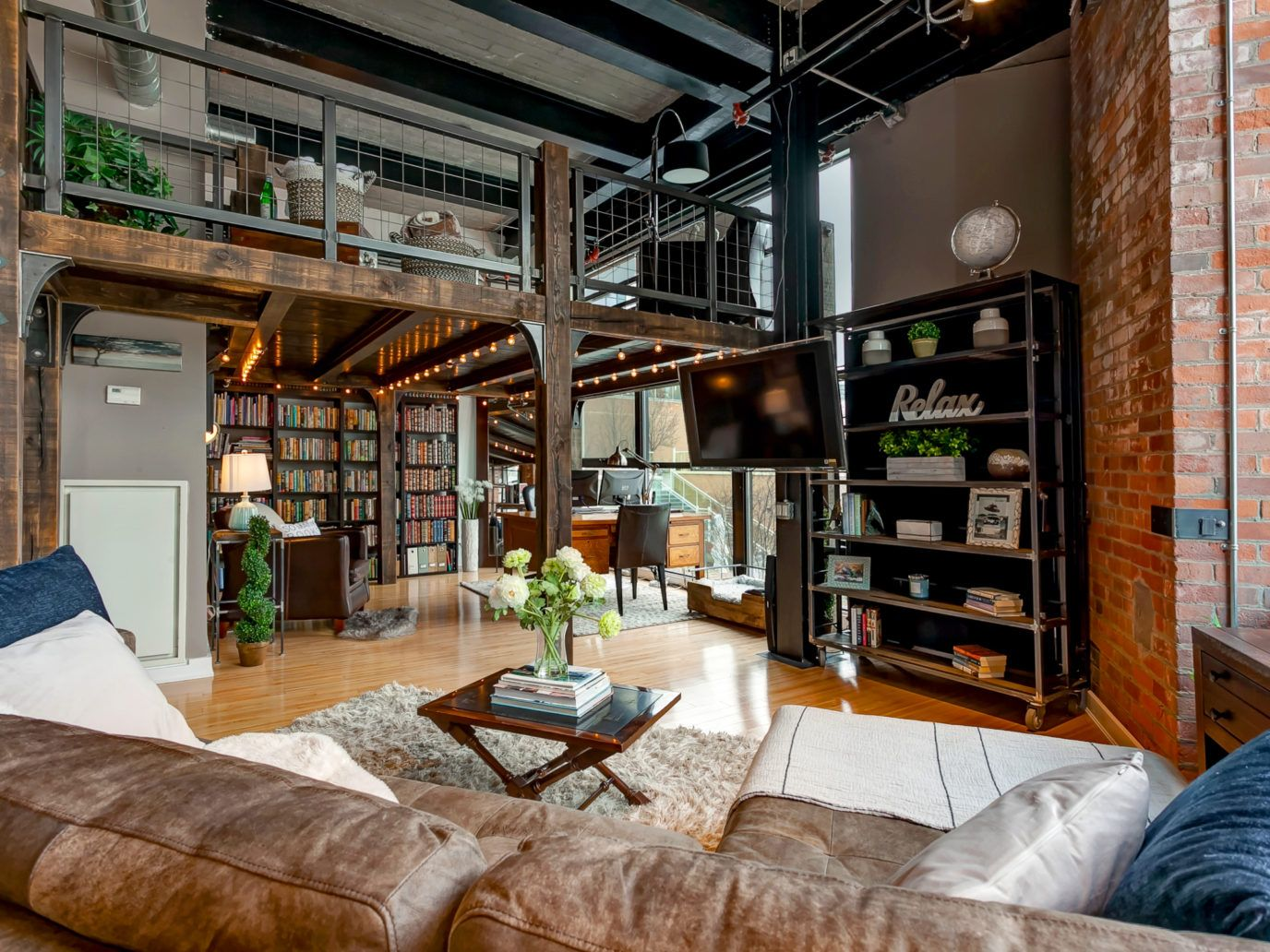 An authentic hard loft with 13-foot ceilings, exposed ...