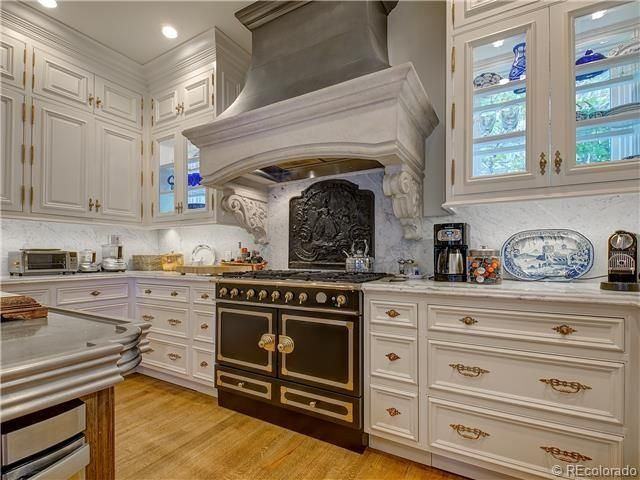 traditional kitchen with double oven range full backsplash stainless steel island top l