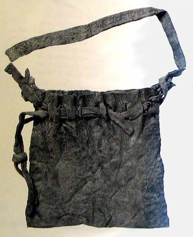 Pouch of leather, 1330-1380 from London excavations. Medieval finds from excavations in London - Dress Accessories, G. Egan, F. Pritchard, HMSO, 1991.