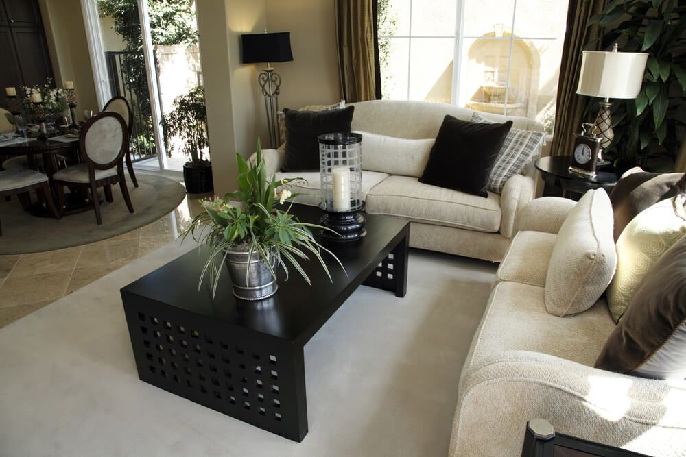 Light And Dark Living Room Design With Off White Sofas Coffee Table On An Area Rug Pillows The Match