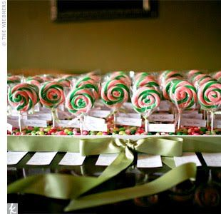You can tie your escort and place cards to your favors. A sweet treat from the start as the escort cards were tied to pink and green lollipops and anchored in boxes filled with jelly belly's.