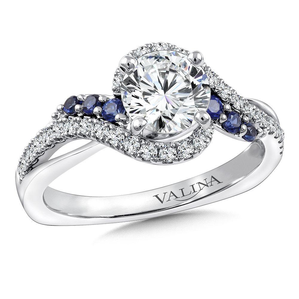 Diamond and blue sapphire crisscross engagement ring