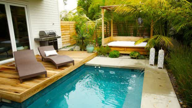 Outdoor Swimming Pool For Small Yard Design With Two Minimalist Chairs And Bed Around Mini