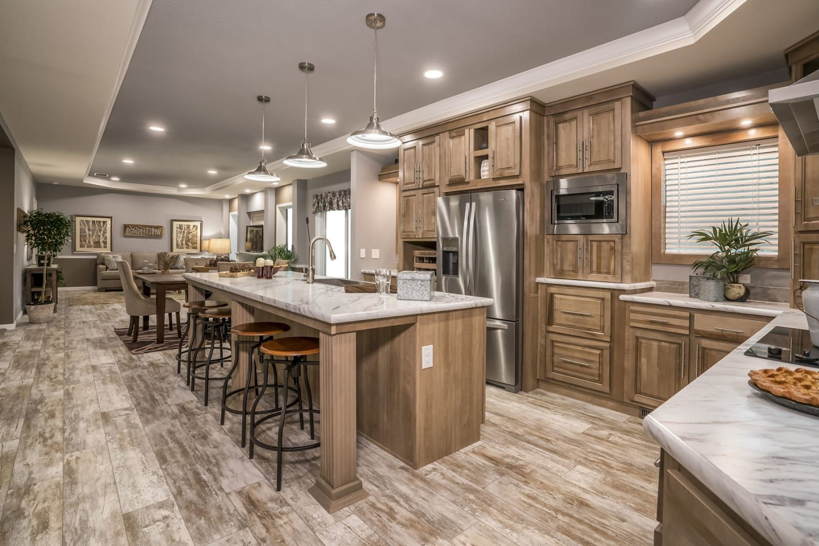 Gourmet kitchen with stainless steel appliances, pendant lighting ...
