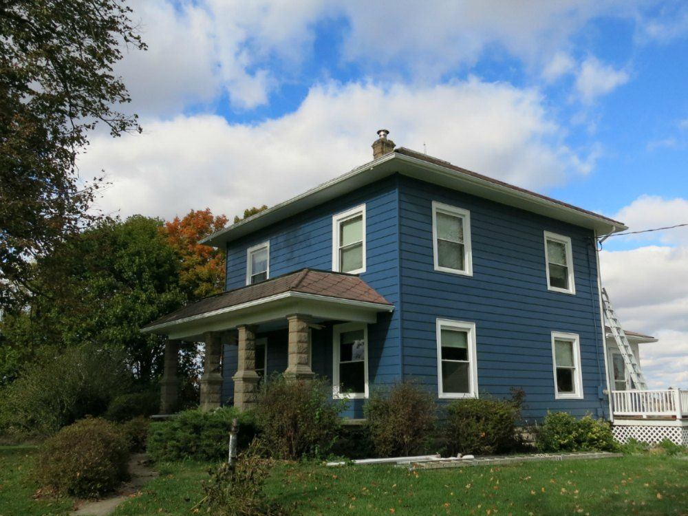 My House With The Aluminum Siding Painted Blue But Absent The Trim House Colors Exterior House Colors Exterior Paint Colors