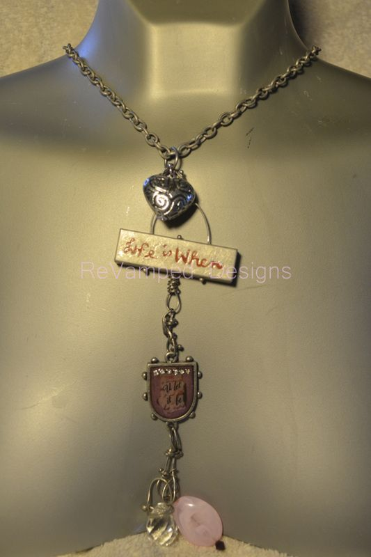 You Let it Be necklace several different charms on chain in a  whimsical dangling piece $30