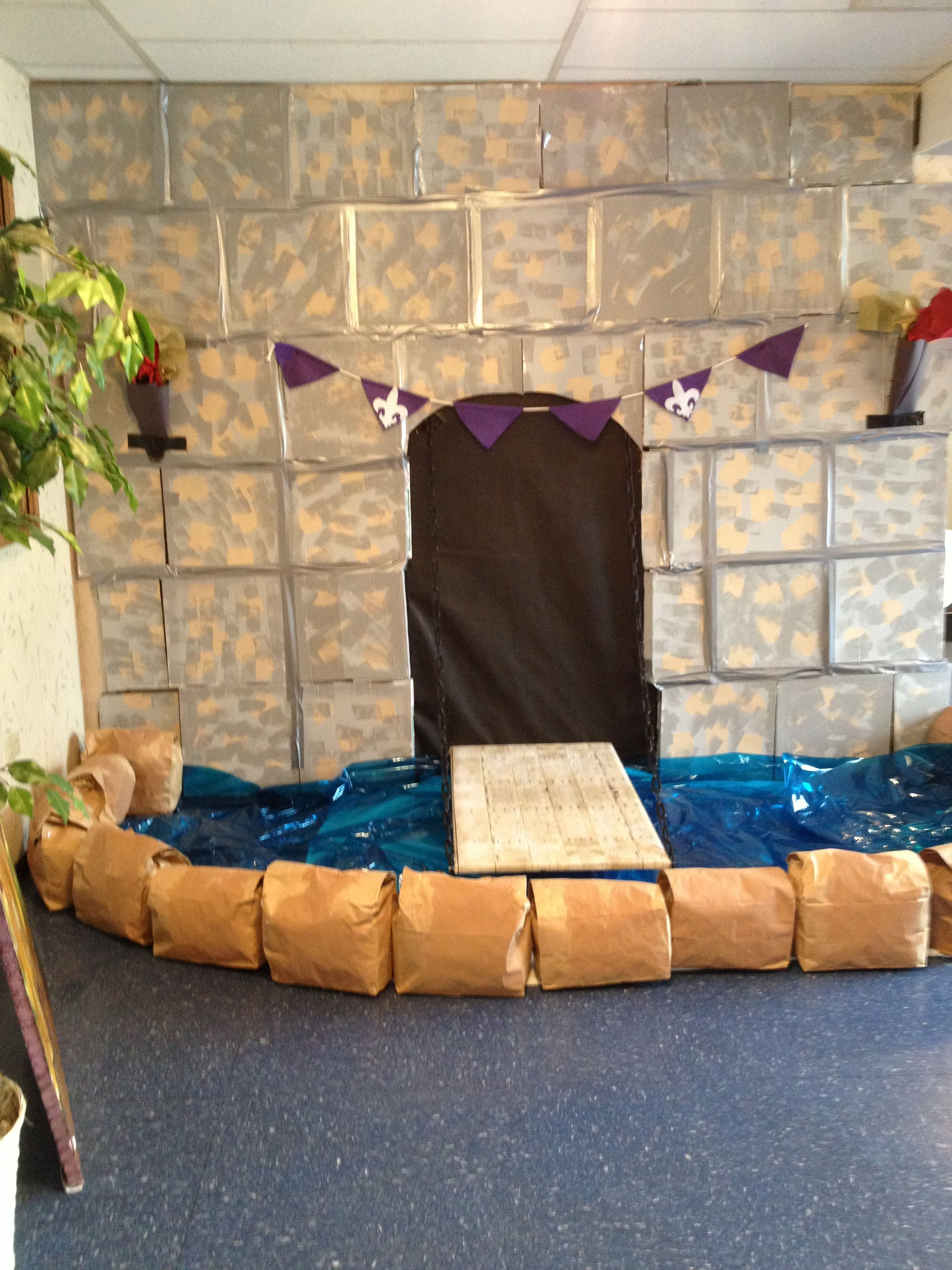 vbs decor. castle wall with moat. wall is made out of pizza boxes