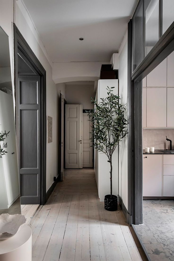 Olive tree and warm natural shades: pleasant Scandinavian apartment in Stockholm