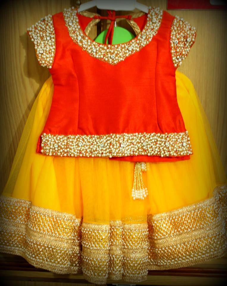 c1de0cd3d60aa0 Yellow Netted Langa With Double Border and Red Blouse With Maggam ...