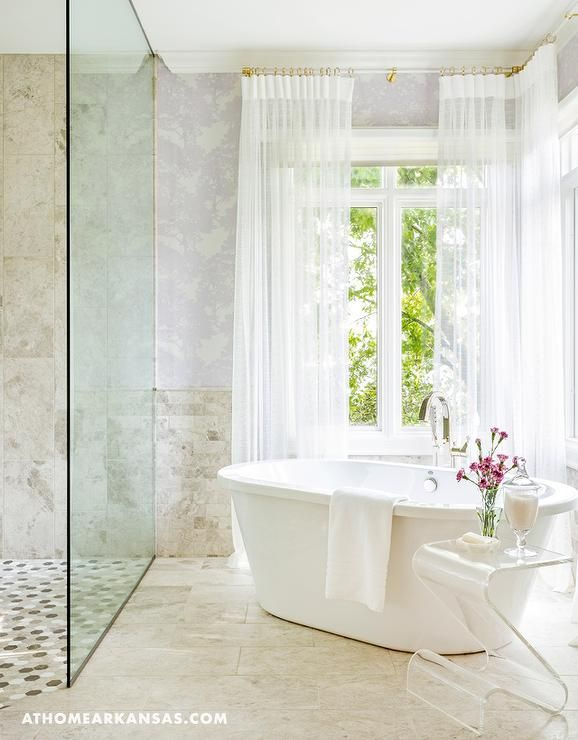 Contemporary bathroom features a freestanding tub placed ...