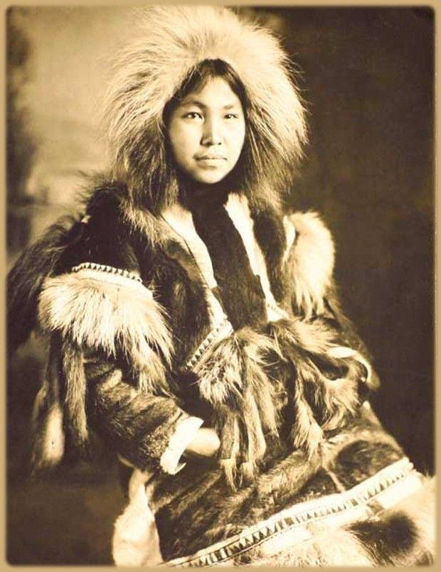 417fc135597 Studio portrait of a young Eskimo woman dressed in a fur parka. c. 1913.