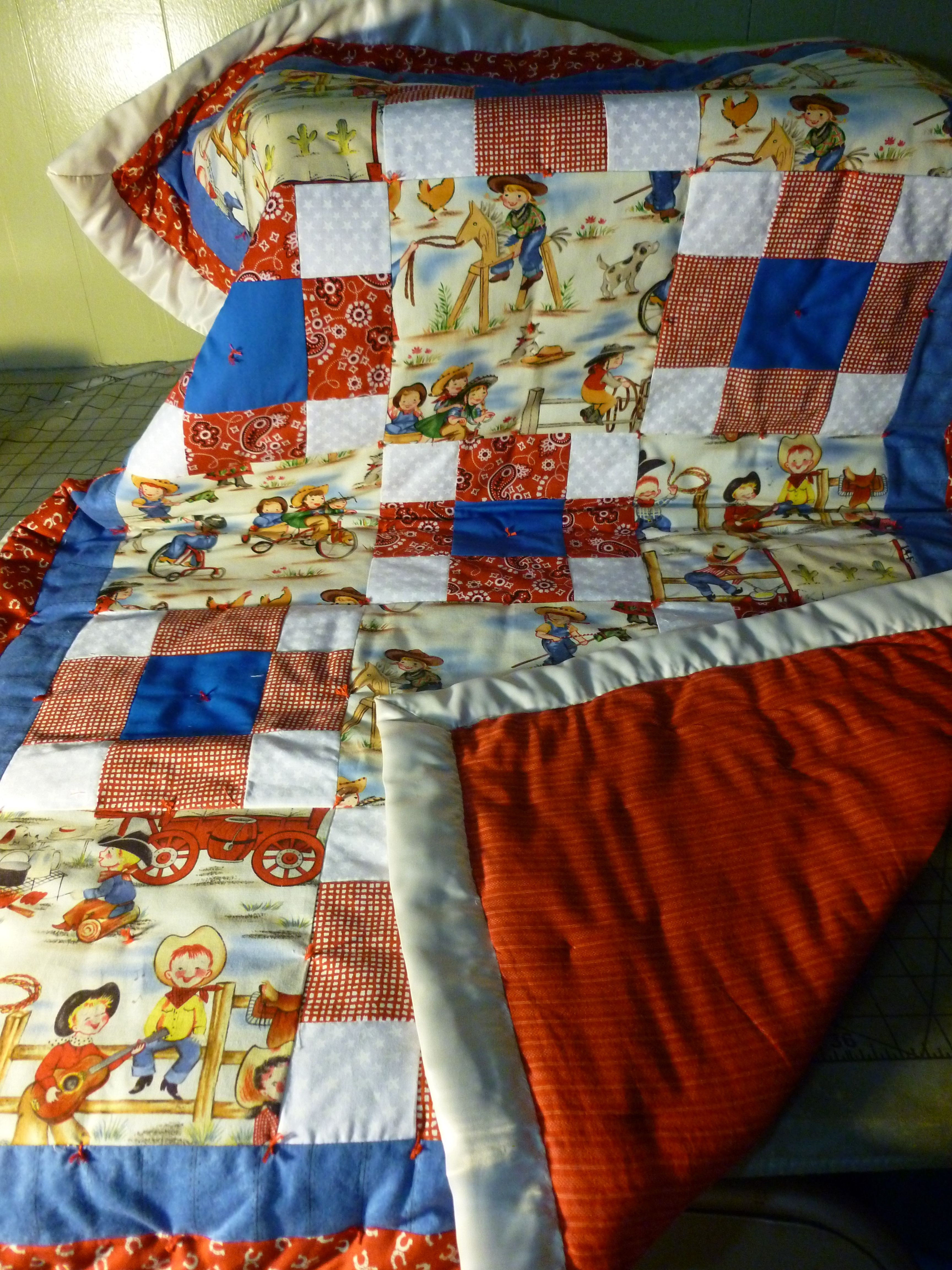 Little cowpoks and cowgirls crib size retro quilt. Hand tied.