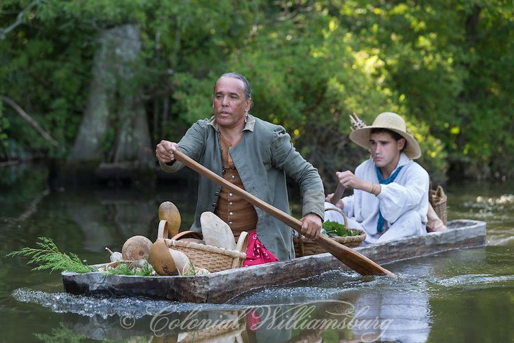 Transportation book shoot at Powhatan Creek .  18th Century scene of Powhatan Indians bringing goods for trade with a dugout canoe.  Photo by David M. Doody