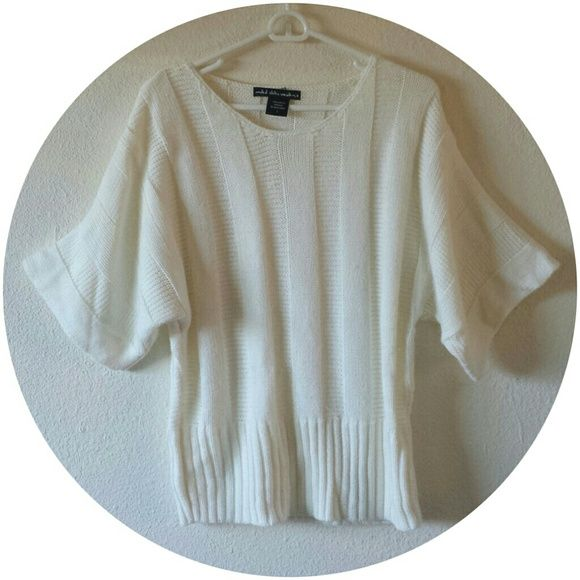 FREE SHIPPING* United State Sweater It's like batwing sleeve sweater.  Gently used.  Cream/white color easy to pair with other accessories in the Fall/Winter.  All sales are final.  FREE SHIPPING* Make an offer of $5 less than the listed price using the *Offer* button! Bundle and Save even more.  Happy Poshmarking! United State Sweater Sweaters Crew & Scoop Necks
