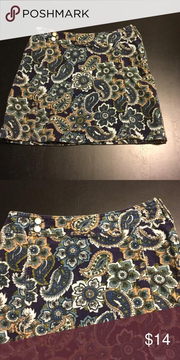 Cute paisley and floral mini skirt Cute paisley and floral mini skirt. Runs more like a S/M Cherokee Skirts Mini