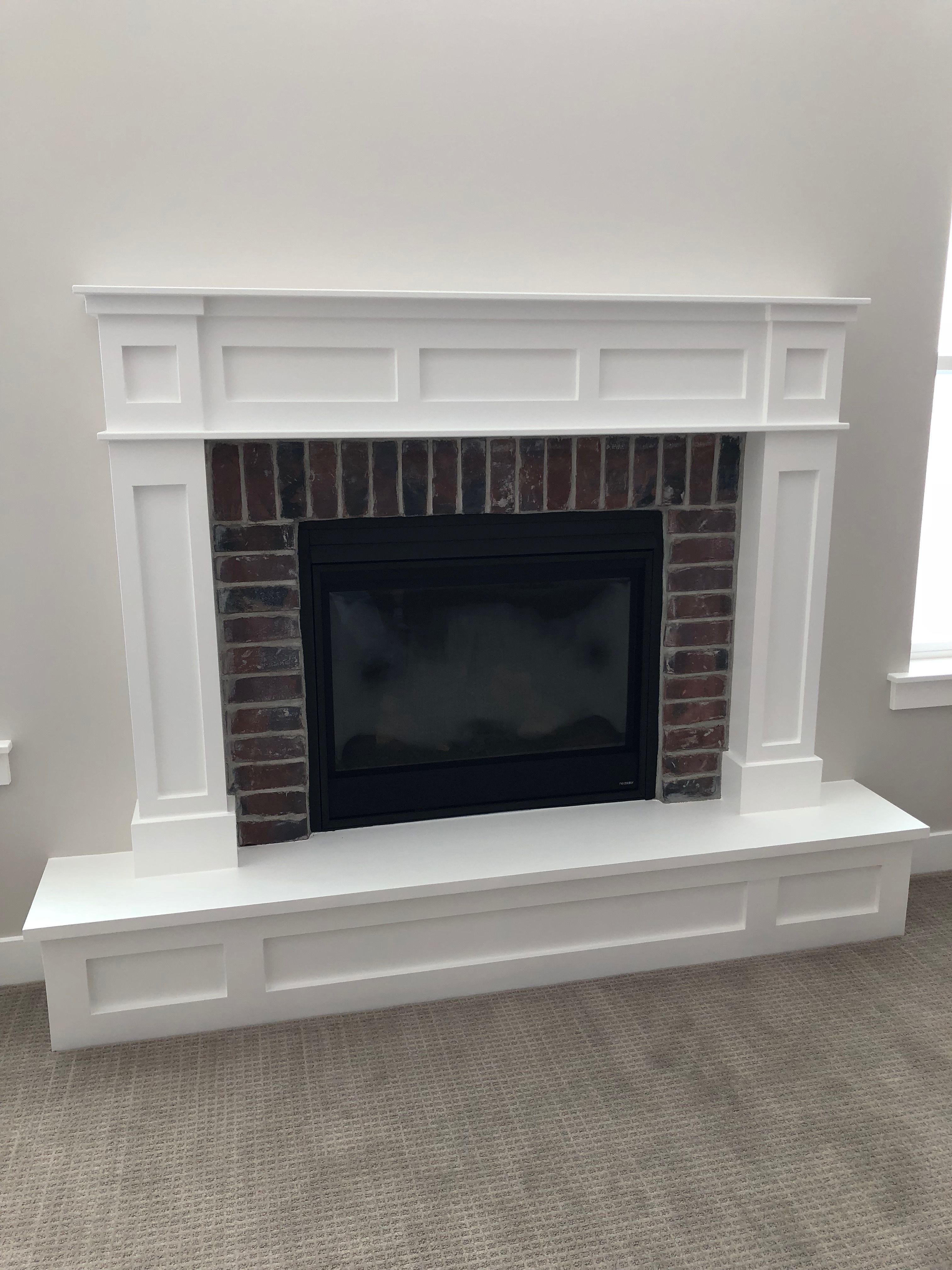Our fireplace mantle and raised hearth White Craftsman