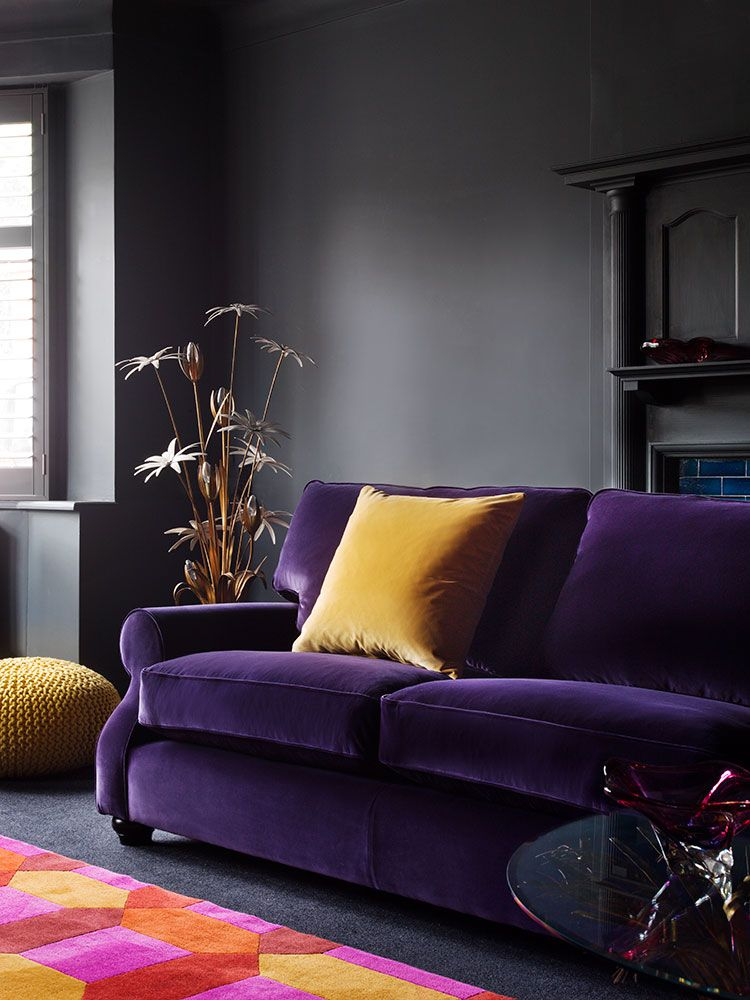 Plush Purple Velvet Sofa With Mustard Yellow Pillow