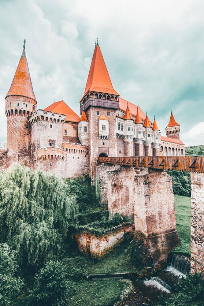 The Corvin castle in Romania is often cited as the inspiration for Bram Stoker's Dracula. Regardless if that is true or not, it definitely fits the vampire theme for me. Check out 20 of the most beautiful castles in the world on avenlylanetravel.com #AVEN