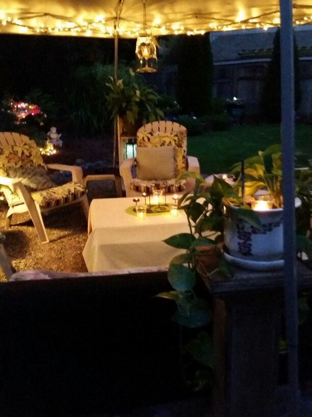 Adding lights and plants to your outdoor living space really makes it cozy.