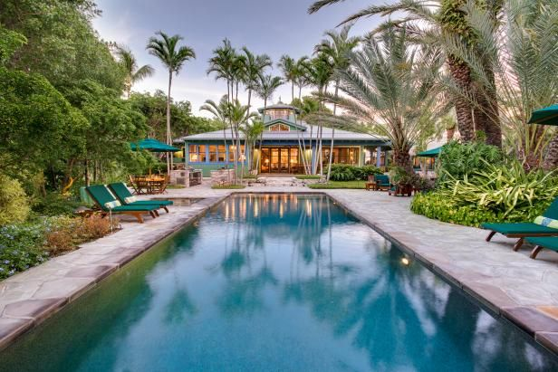 With a private beach, thatched-roof covered patios and tropical-style landscaping, this home is the ultimate oceanfront getaway.