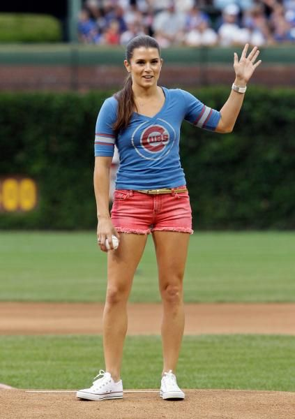 Danica dons her Chicago Cubs T-shirt as she gets ready to throw out the ceremonial first pitch before a Cubs game at Wrigley Field last year. A native of Roscoe, Ill., Patrick is a fan of the Chicago sports teams. (Nam Y. Huh/AP)