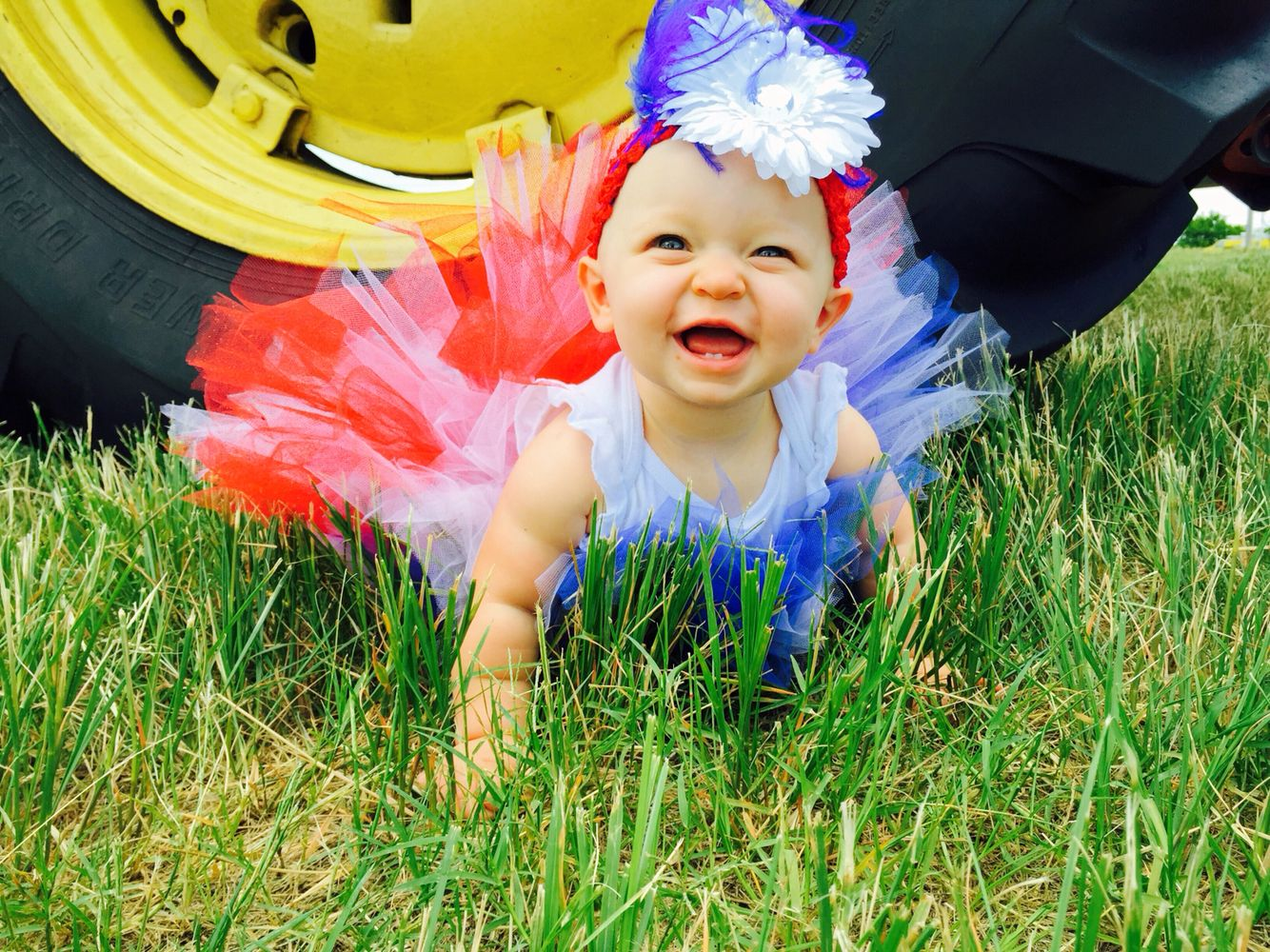 My baby's 1st 4th of July pictures. Red white and blue diy tutu and headband. John Deere tractor