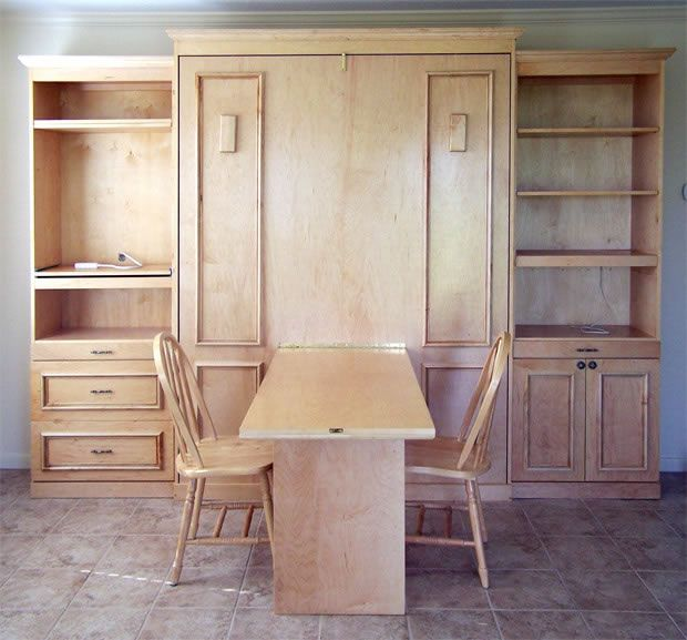 murphy bed desk folds. this desk converts to a murphy bed. folds up, bed down.