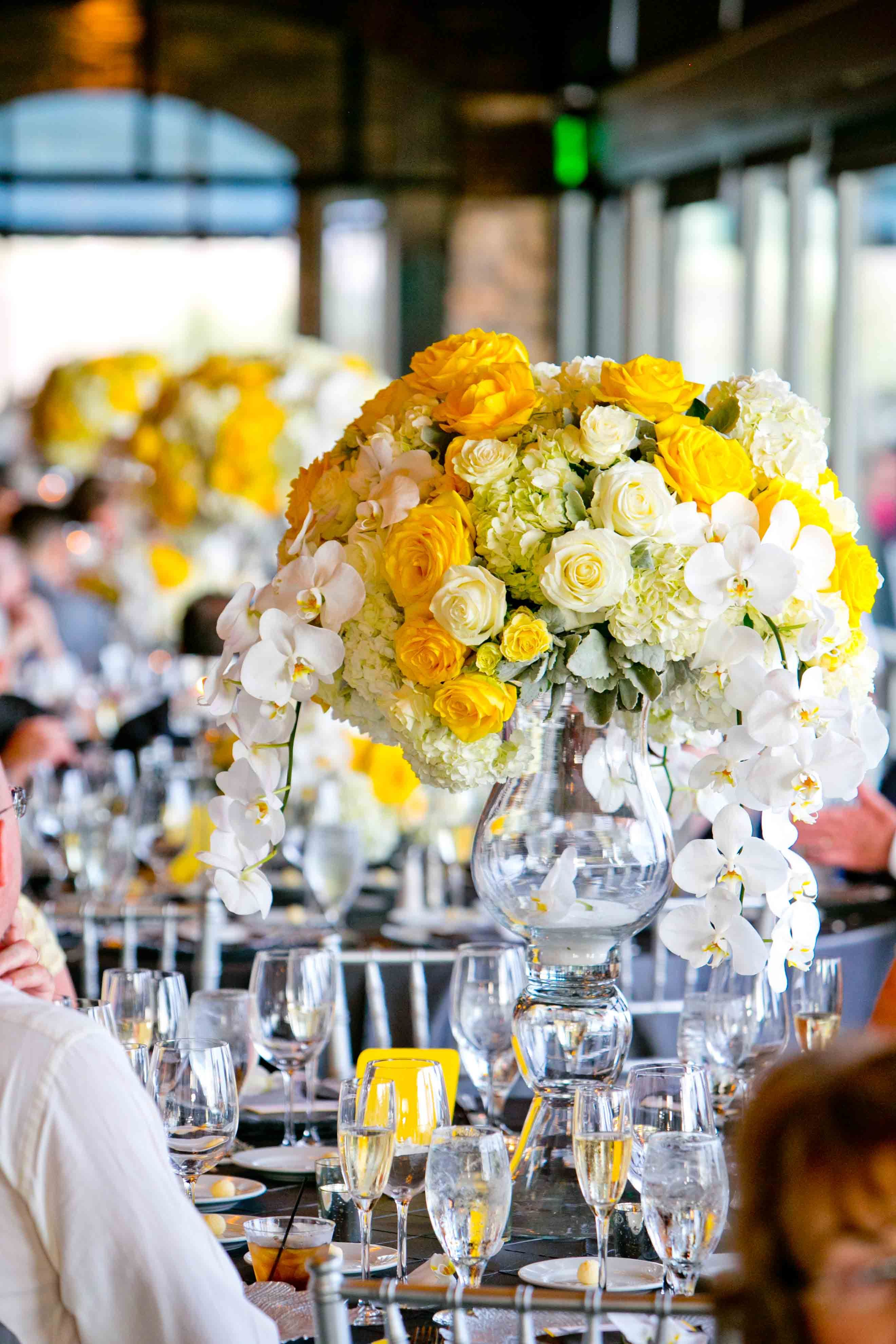 White And Yellow Floral Arrangements For The Wedding Reception