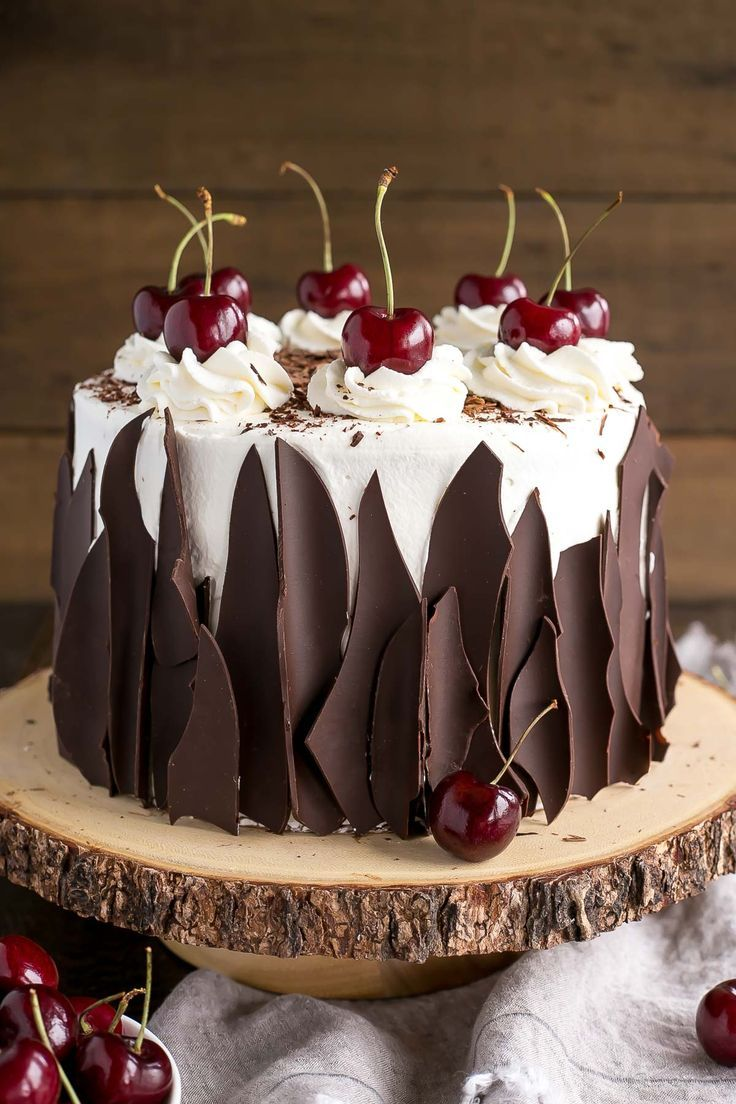 This Black Forest Cake combines rich chocolate cake layers with fresh cherries, cherry liqueur, and a simple whipped cream frosting. | livforcake.com #frostings