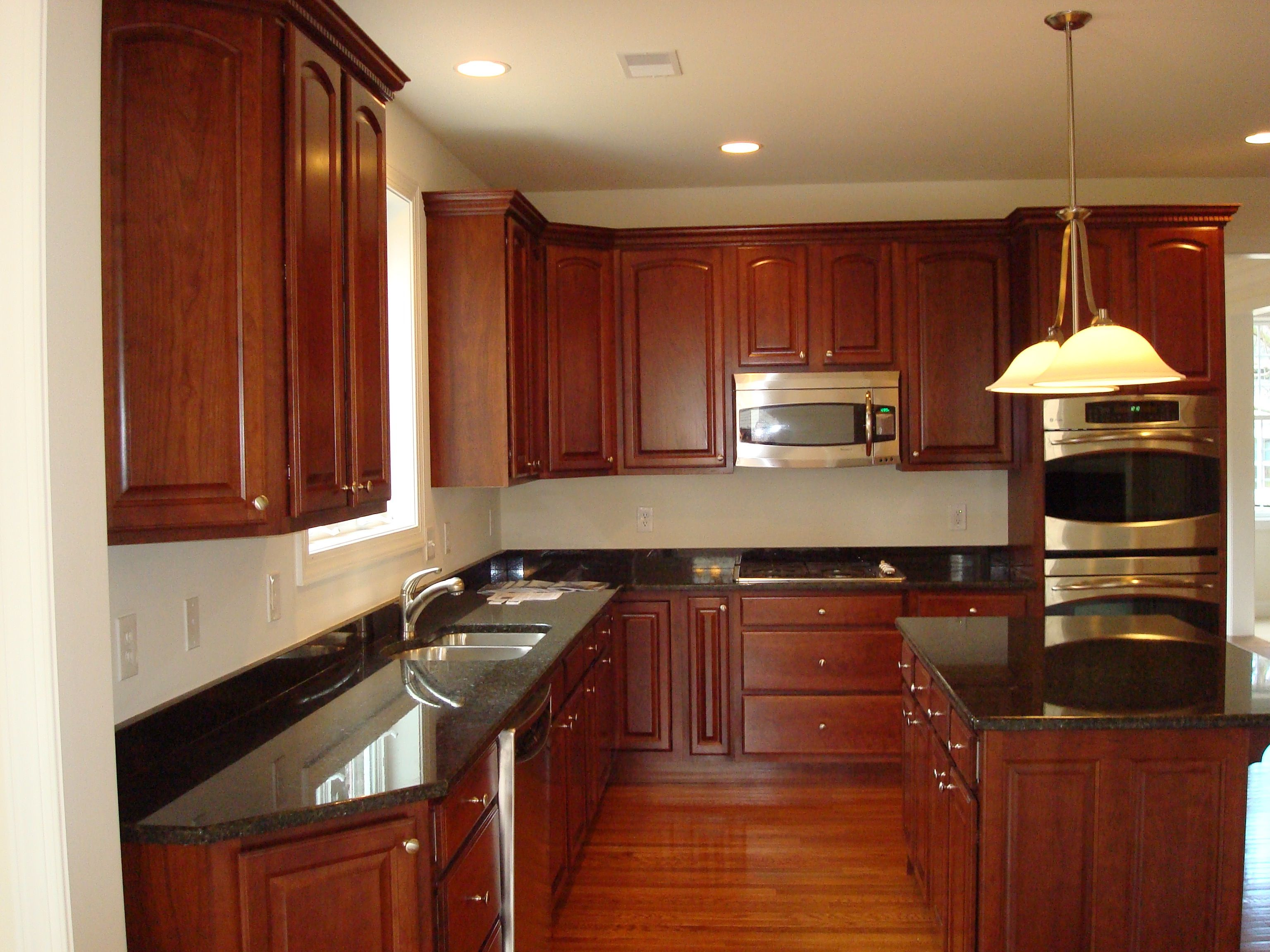 Black granite w dark cabinets townhouse pinterest for Floors to match cherry cabinets