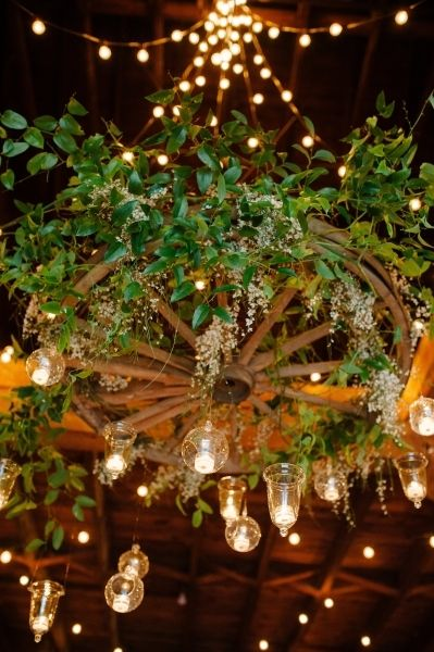 Wagon Wheel Turned Floral Chandelier With Greenery And