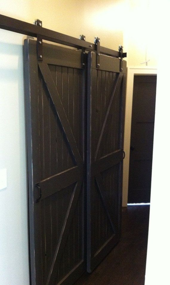 Double bypass sliding barn door hardware by for Barn door closet hardware
