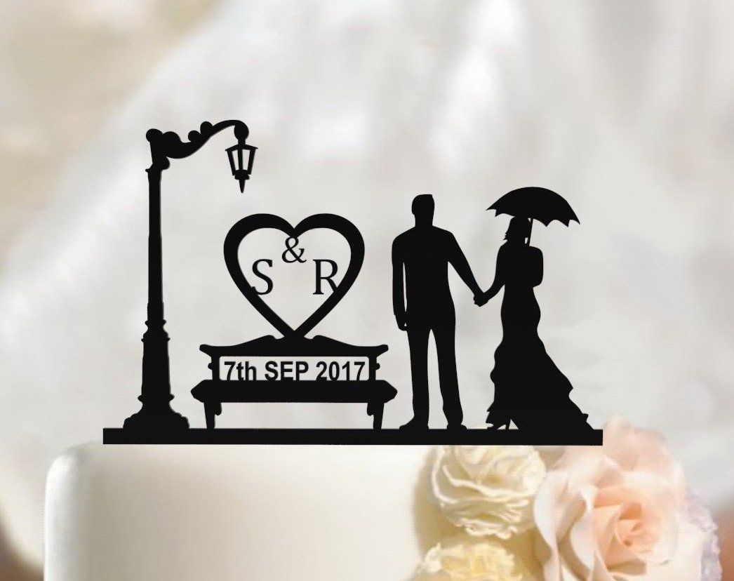 Bride and groom silhouette wedding cake topper hearth