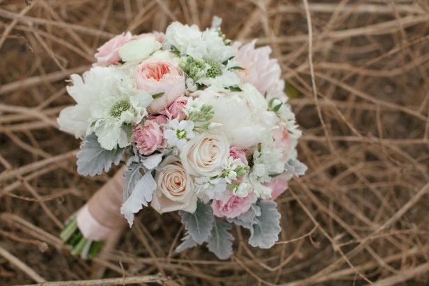Peonies, peach Juliet roses, pink Majolica spray roses, 'Cafe au Lait' dahlias, ranunculus, scabiosa and dusty miller define this bouquet