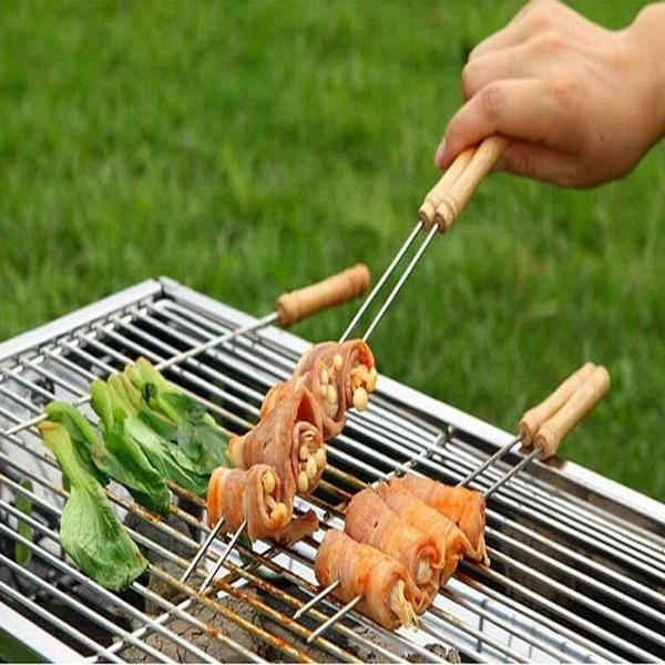 """10 Piece Barbecue Skewer Set - Let the BBQ Reign –  Be the Master of your grill with this set of 10 Stainless Steel BBQ Skewers with Wood Handle. Each skewer is 11.8"""" long with handle (8.5""""Skewer). Great for kebabs, S'Mores, and everything that yourpit master mind can think of. Made from Rust Resistant and Easy to Clean Stainless Steel. The needle sharp tip makes your kababs easier to construct so you don'thave topierce through all those veggies with a wooden skewer.  Go Go Kitchen…"""