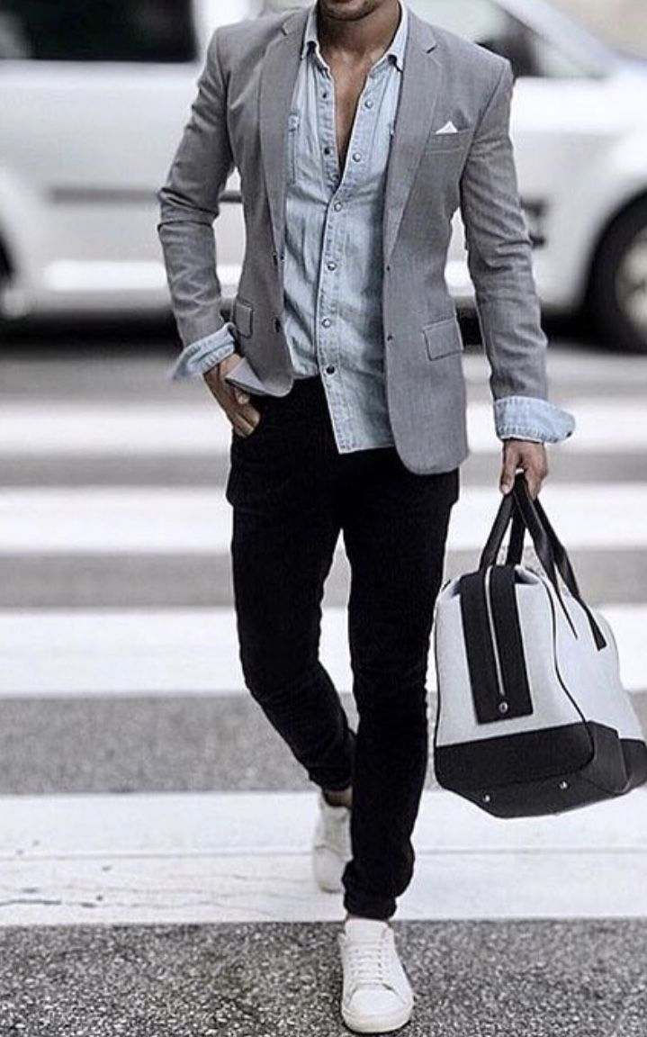 Grey sport coat teamed with a light blue untucked shirt