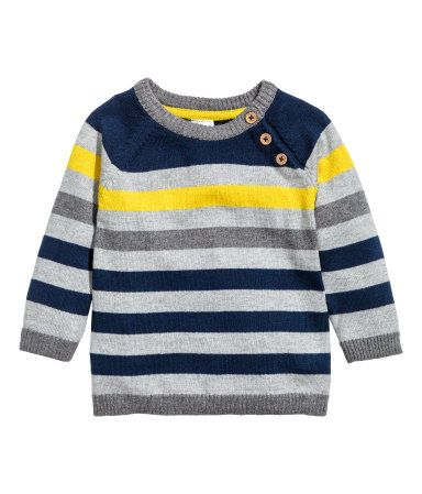 Gray/striped. Sweater in a soft, fine knit with contrasting ribbing at neckline, cuffs, and hem and diagonal button placket at top.