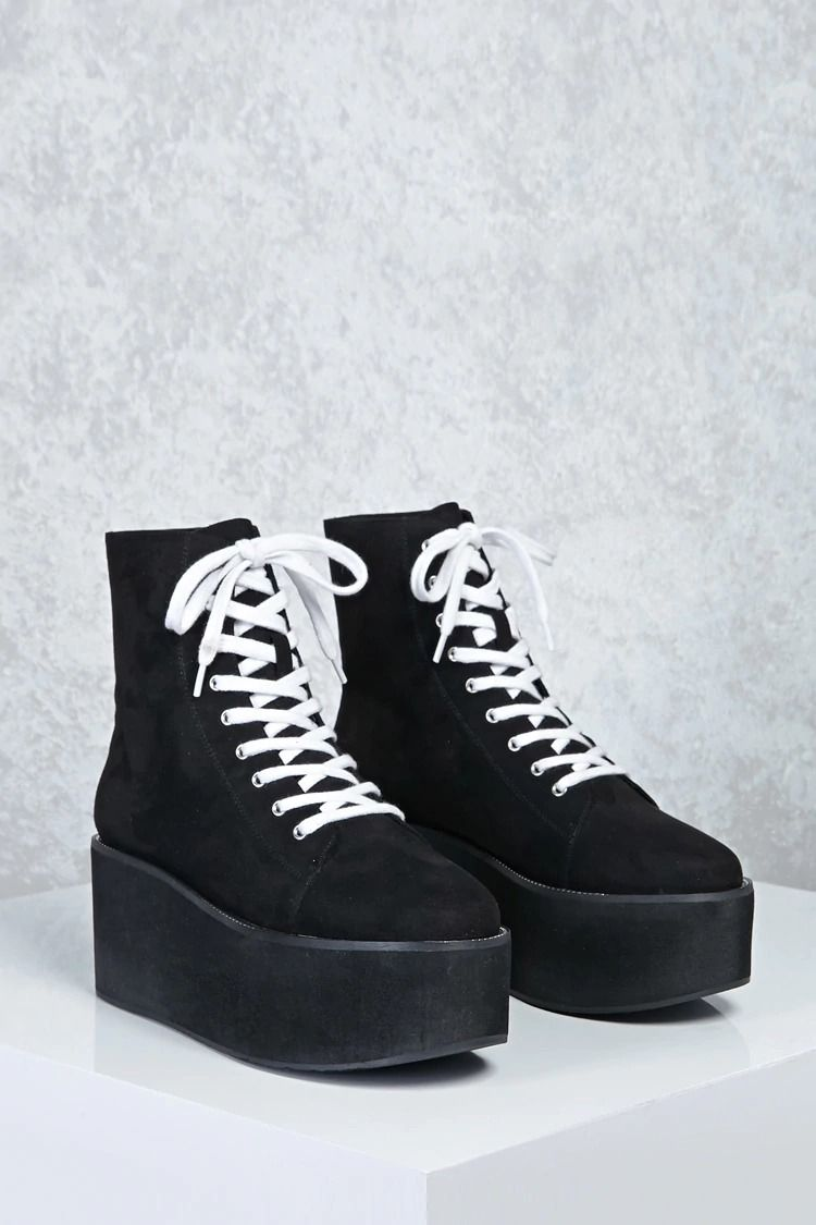 A pair of high top sneakers in a faux suede featuring a lace-up front 58fb7036fd