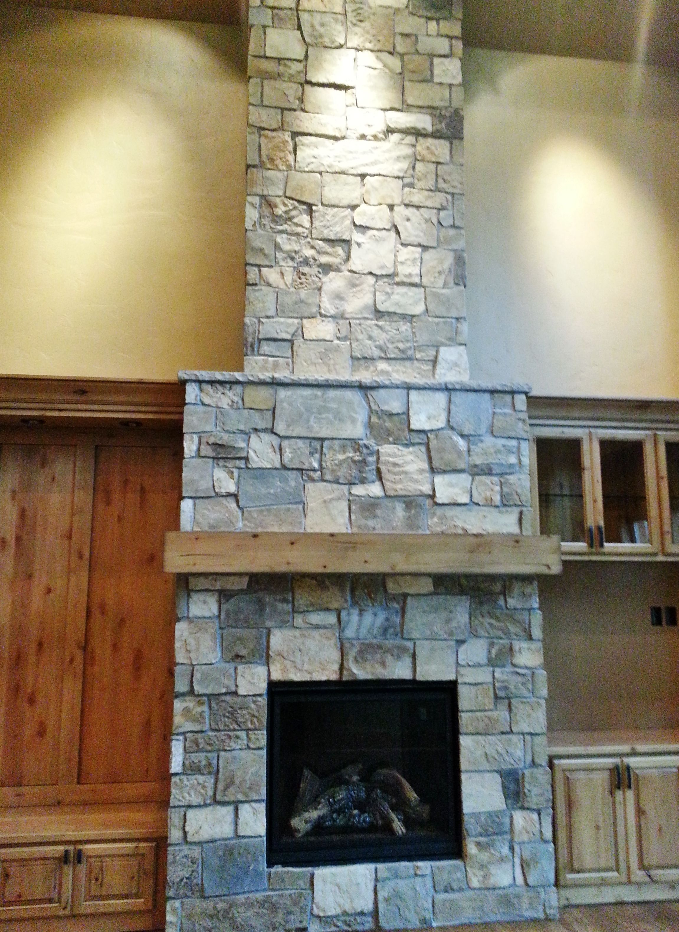 Natural Stone, New Construction, Living Room, Fireplace, Wood Built In  Surroundings