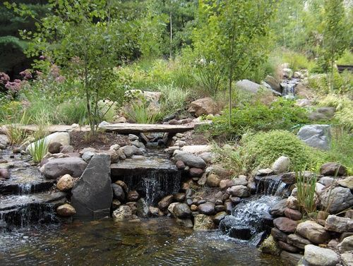 Waterfall into large pond constructed using fieldstone for Large pond waterfall