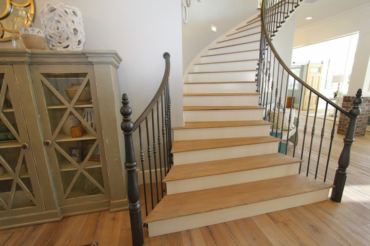 This beautiful spiral staircase spans all four floors of this amazing home.  Intricate iron railings add an exquisite look to the already amazing staircase.