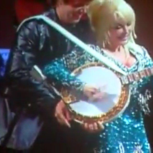 Dolly playing her banjo player's banjo. lol