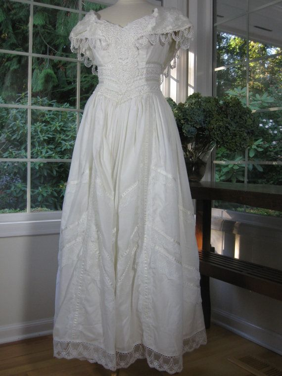 Jessica McClintock vintage wedding dress 70s, 80s  This dress reminds me of Downton Abbey. I love the fabric - the shell is cotton and lining is polyester. ♥ Adorable vintage off-white wedding dress!  ♥ Back zipper.  ♥ Free hip  ♥ Made in USA    * measurements *    Measurements are taken in inches with the garment laying flat.  Measurements are then doubled where appropriate.    Fits like: Medium Size 8 on label  Shoulder to Shoulder: 14  Bust : 35  Waist : 28 Hips: Free  Length measured…